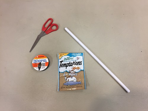 scissors, electrical tape, treat pouch, dry cleaner hanger tube