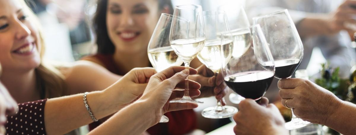 Friends raises glasses of wine